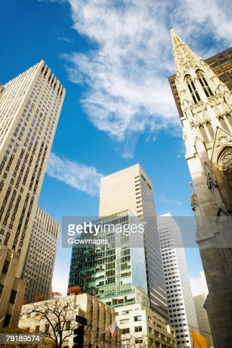 Low angle view of skyscrapers in a city, St. Patrick's Cathedral, Manhattan, New York City, New York State, USA : Stock Photo
