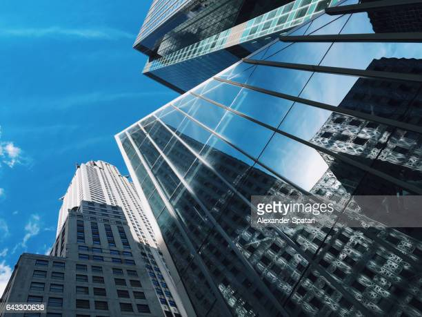 Low angle view of skyscrapers on Manhattan, New York, United States