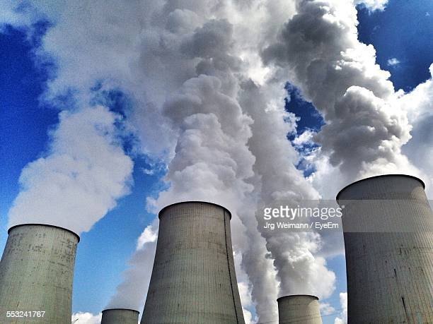 Low Angle View Of Smoke Stack Emitting Smoke