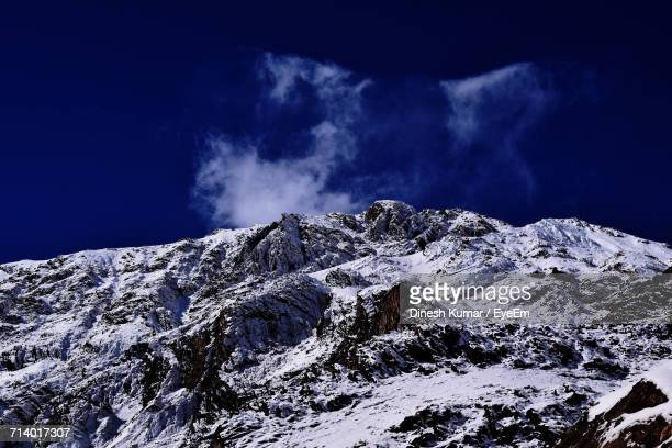 Low Angle View Of Snow Mountain Against Sky