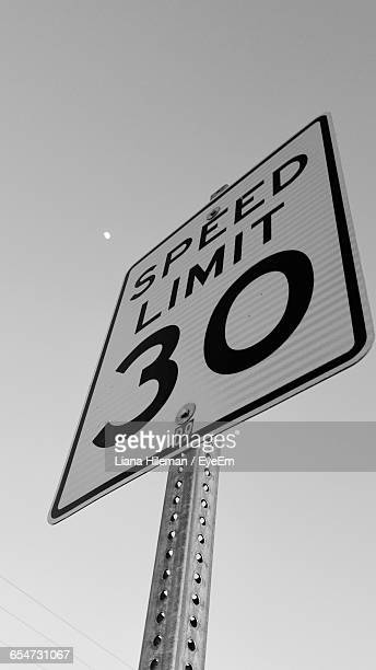 Low Angle View Of Speed Limit Sign Against Sky