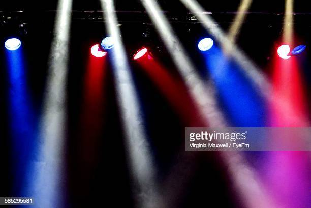 Low Angle View Of Spotlights On Stage At Concert