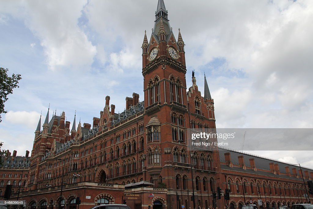 Low Angle View Of St Pancras Railway Station Against Cloudy Sky
