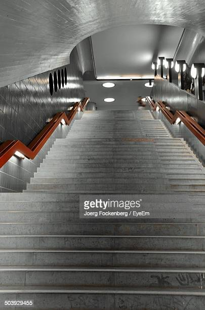 Low angle view of stairs and brown hand rails