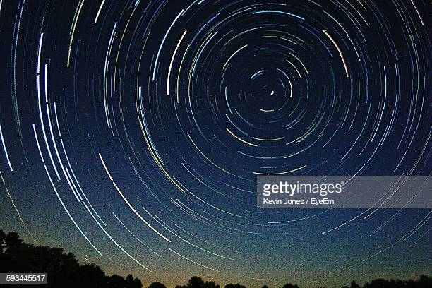 Low Angle View Of Star Trails Against Sky