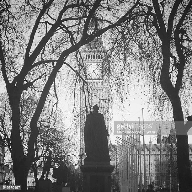 Low Angle View Of Statue Against Big Ben At Parliament Square