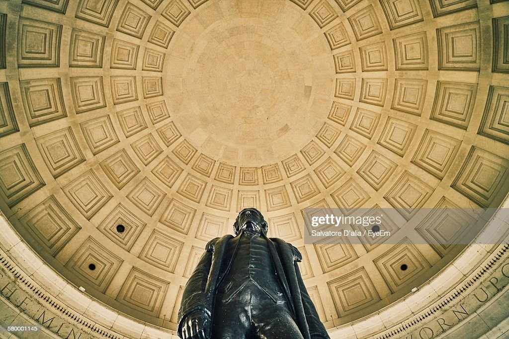 Low Angle View Of Statue Against Cupola At Thomas Jefferson Memorial