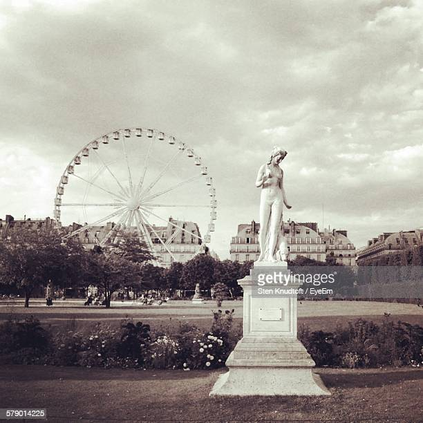 Low Angle View Of Statue At Jardin Des Tuileries Against Buildings And Sky
