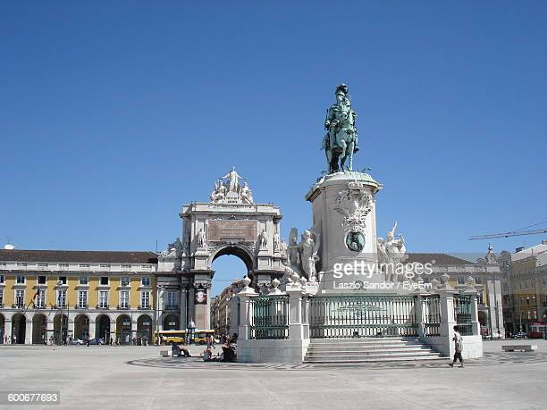 Low Angle View Of Statue At Praca Do Comercio Against Clear Blue Sky