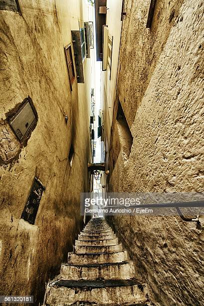 Low Angle View Of Steps Amidst Old Buildings