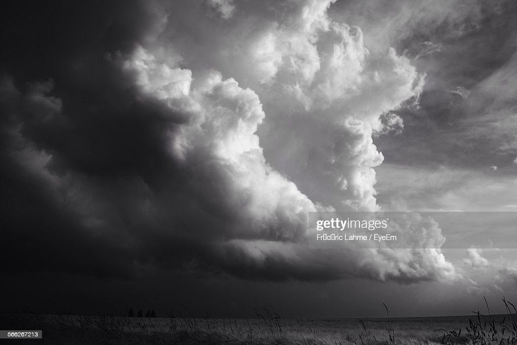 Low Angle View Of Storm Clouds Over Field