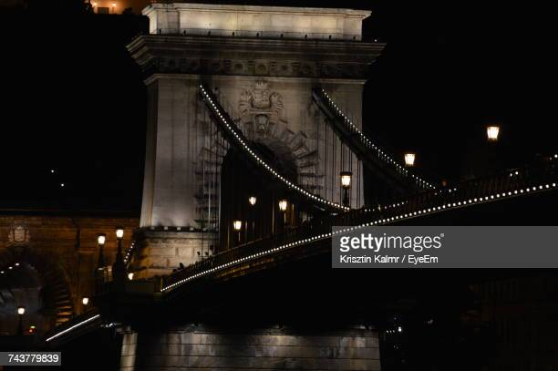 Low Angle View Of Suspension Bridge At Night