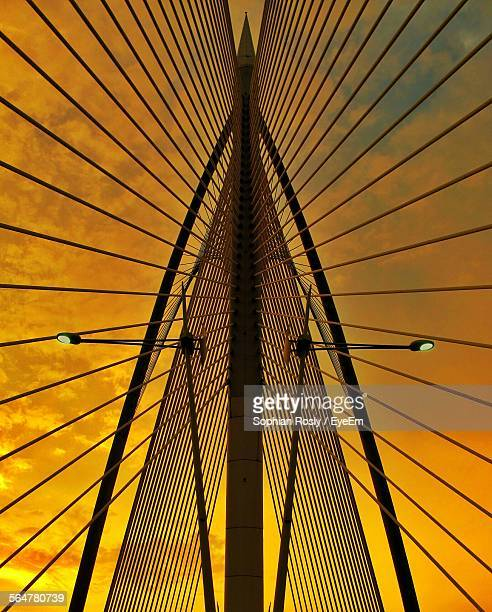 Low Angle View Of Suspension Bridge During Sunset