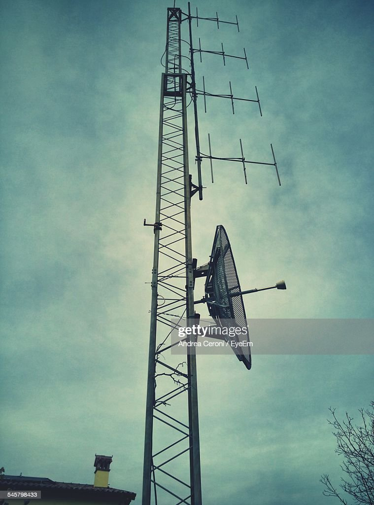 Low Angle View Of Telecommunication Antenna Against Blue Sky