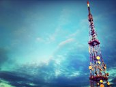 Low angle view of television tower against cloudy sky