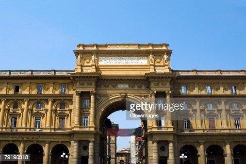 Low angle view of the entrance gate of a market square, Uffizi Museum, Florence, Tuscany, Italy : Stock Photo