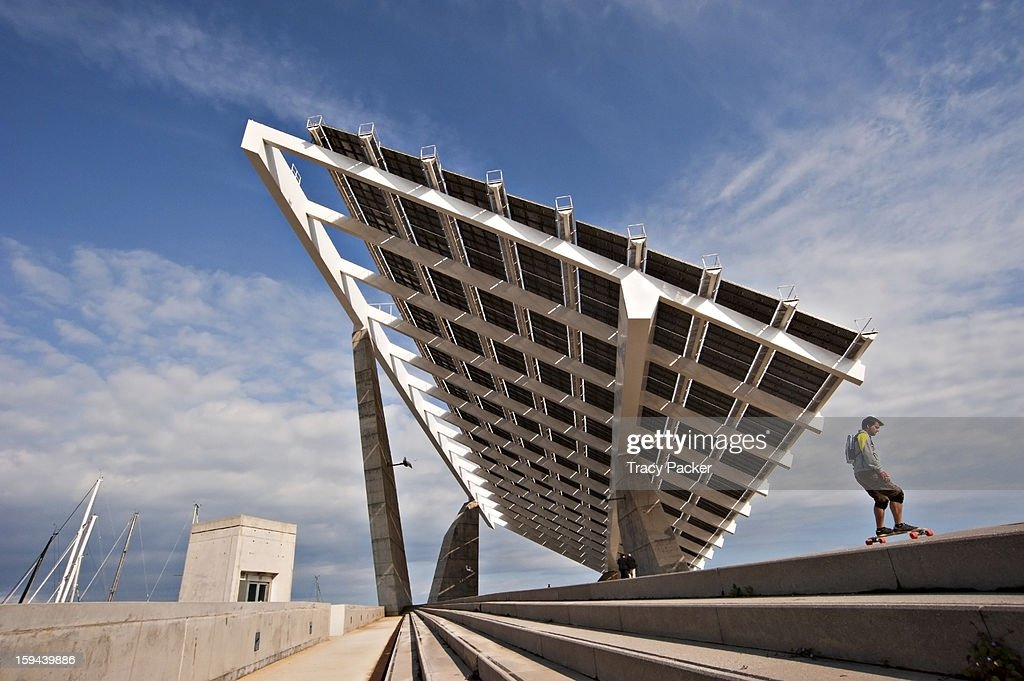 CONTENT] A low angle view of the large Photovoltaic (PV) Pergola designed by Torres & Lapena and erected in 2004, being used to harvest renewable energy (solar power)at El Forum in Barcelona. Overlooking the beach, it is also a popular hang-out for local skateboarders.