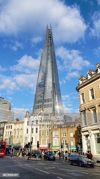 Low Angle View Of The Shard By Street Against Sky