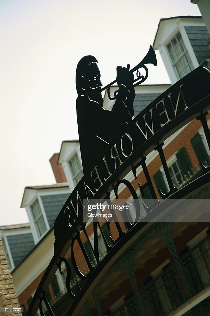 Low angle view of the statue of a man playing the trumpet, New Orleans, Louisiana, USA : Stock Photo