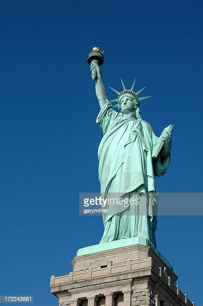 Low angle view of the Statue of Liberty against a clear sky