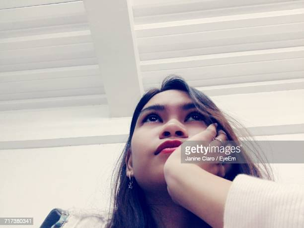 Low Angle View Of Thoughtful Woman