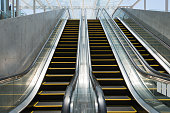 Low angle view of three escalators, which are placed in a modern concourse. An image of architecture detail.(XXXLarge)