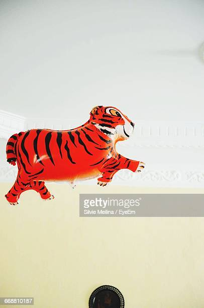 Low Angle View Of Tiger Shape Balloon Against Ceiling