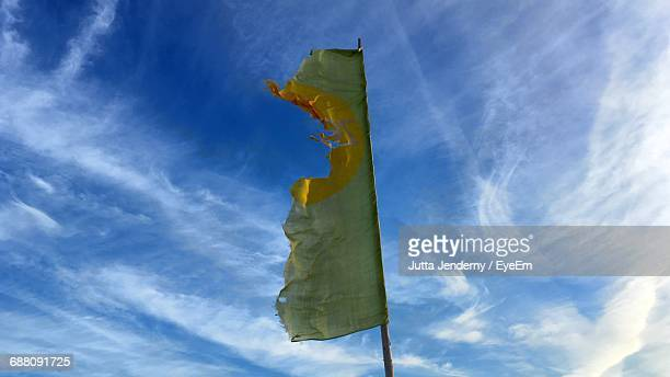 Low Angle View Of Torn Flag