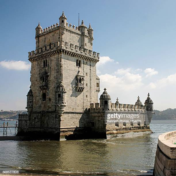 Low Angle View Of Torre De Belem In Tagus River Against Sky