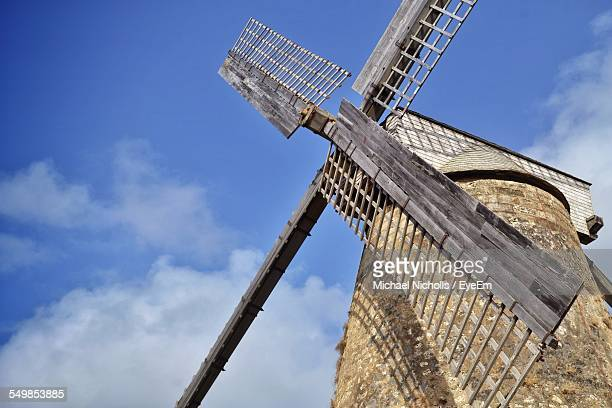 Low Angle View Of Traditional Windmill Against Blue Sky