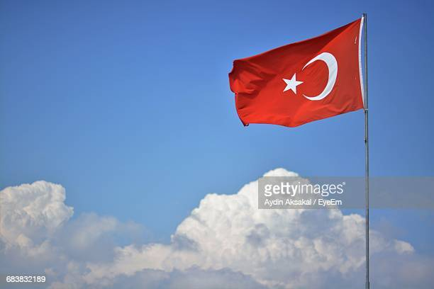 Low Angle View Of Turkish Flag Fluttering Against The Sky