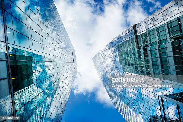 Low angle view of two glass fronted skyscrapers, New York, USA