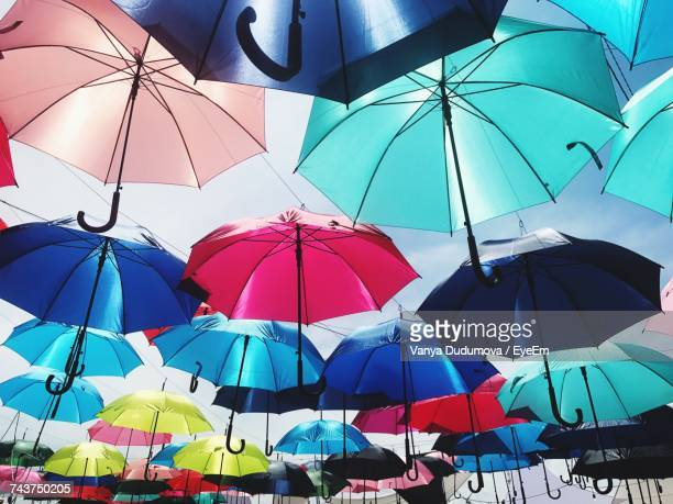 Low Angle View Of Umbrellas Against Sky In Market
