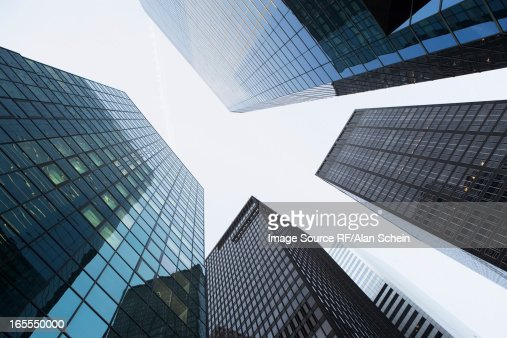 Low angle view of urban skyscrapers