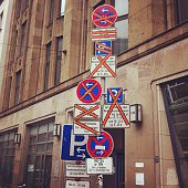 Low Angle View Of Various Road Signs On Street
