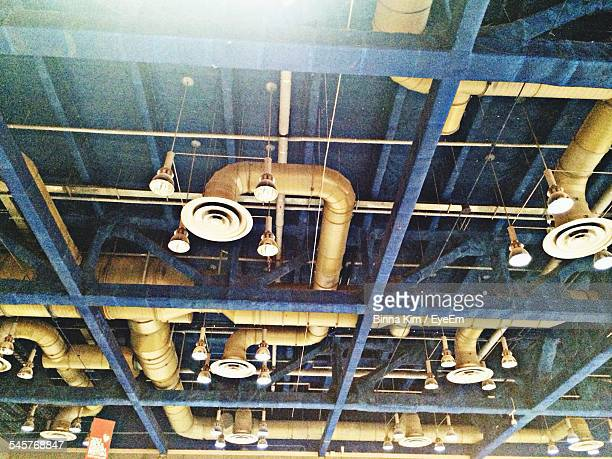 Low Angle View Of Ventilation Ducts On Ceiling