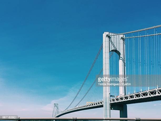 Low Angle View Of Verrazano-Narrows Bridge Against Blue Sky