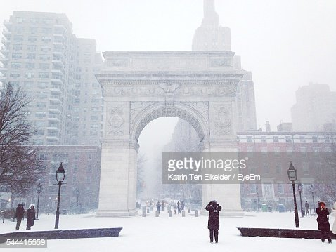 Low Angle View Of Washington Square Arch And Buildings In Foggy Weather