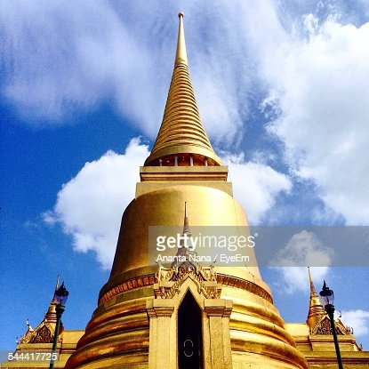 Low Angle View Of Wat Phra Kaew Against Cloudy Sky
