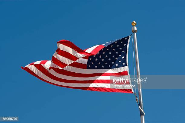 Low angle view of waving American flag