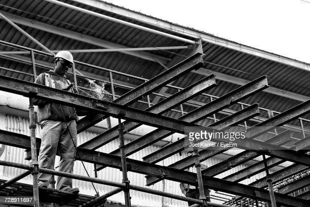 Low Angle View Of Welder Working At Construction Site