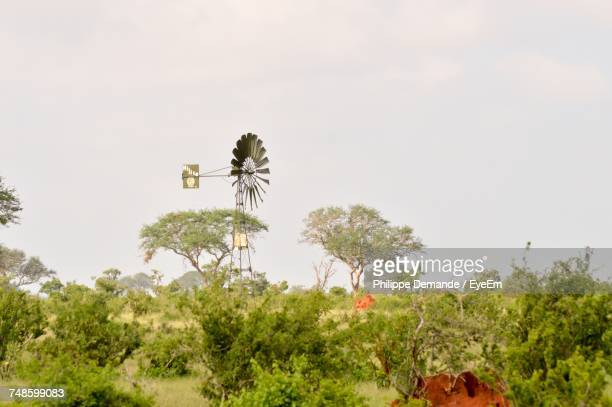 Low Angle View Of Windmill Amidst Plants Against Clear Sky