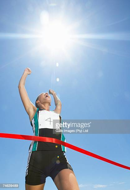 Low Angle View of Woman Finishing Race