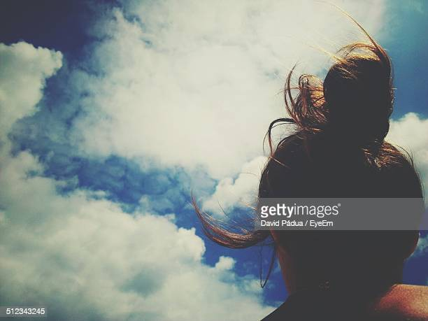 Low angle view of woman head against sky