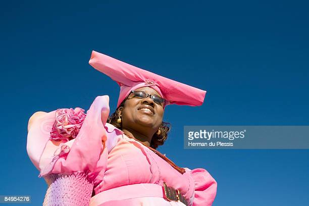 Low angle view of woman in traditional Herero dress, Opuwo, Kaokoland, Namibia
