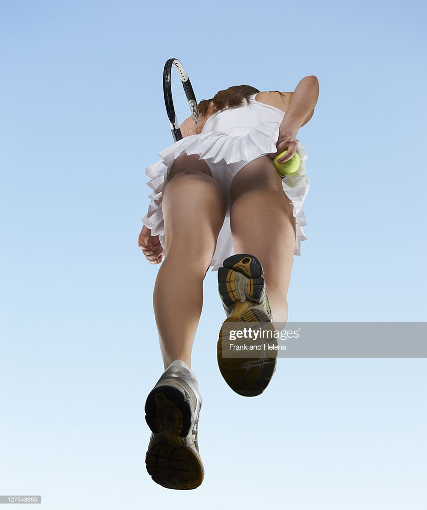 Low angle view of woman playing tennis : Stock Photo