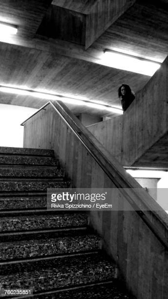 Low Angle View Of Woman Standing By Steps In Building