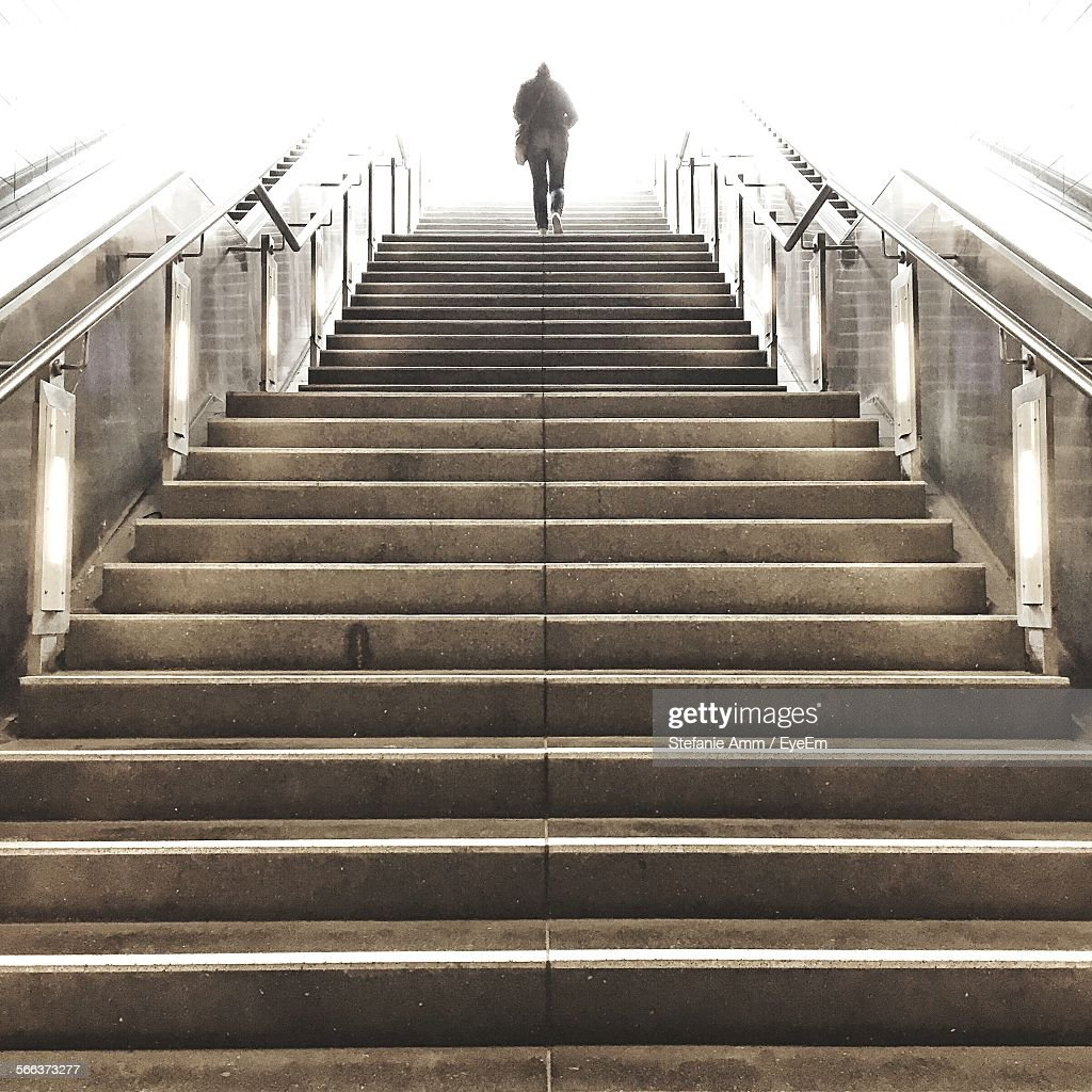 Low Angle View Of Woman Walking Up Stairs
