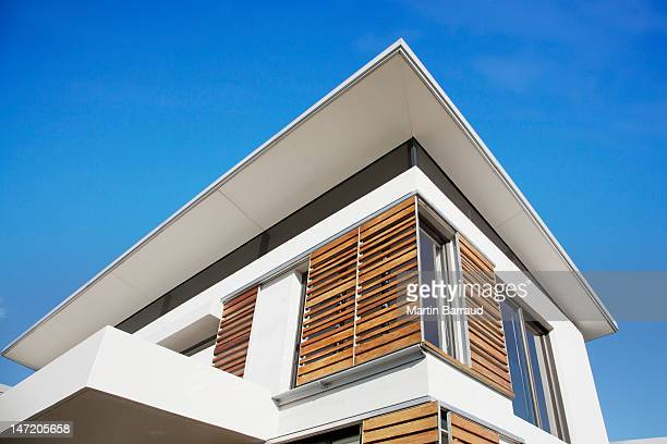 Low angle view of wood shutters on modern house