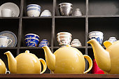 Low angle view of yellow tea kettles